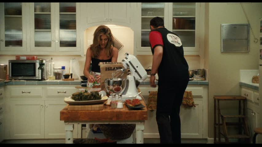 Jennifer Aniston cooking in apartment kitchen