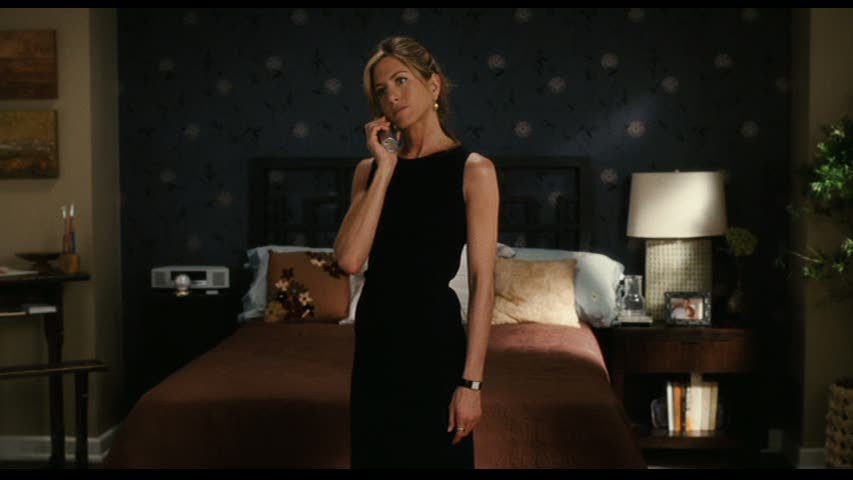 Jennifer Aniston talking on phone in bedroom