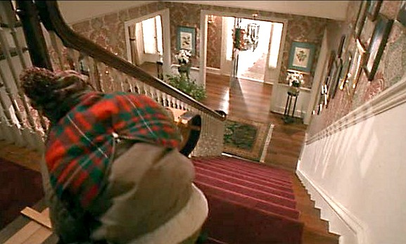 Kevin sledding downstairs in Home Alone movie