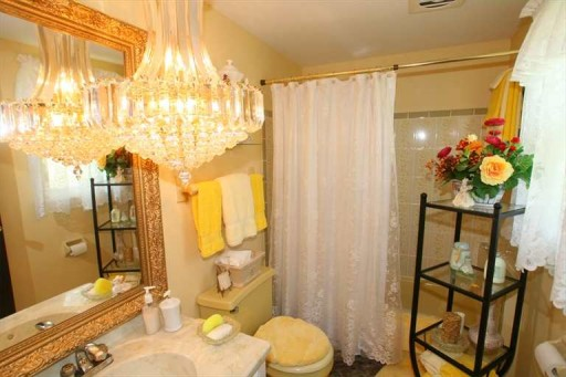 bathroom with giant chandelier