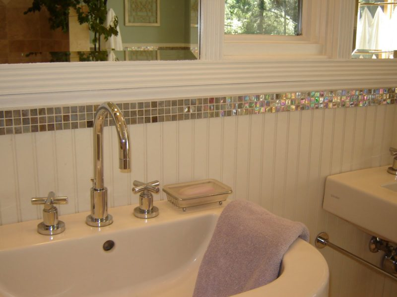 close-up of sink detail and glass tiles
