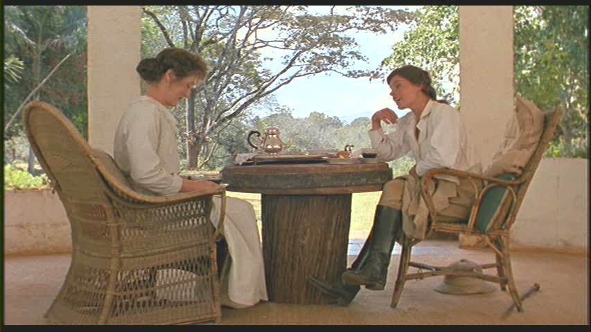 Karen and Beryl Markham sitting at table together in Out of Africa