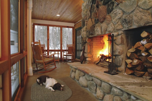 Stone fireplace-screened porch