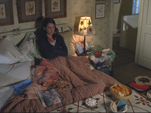 Lorelai sitting in her bed