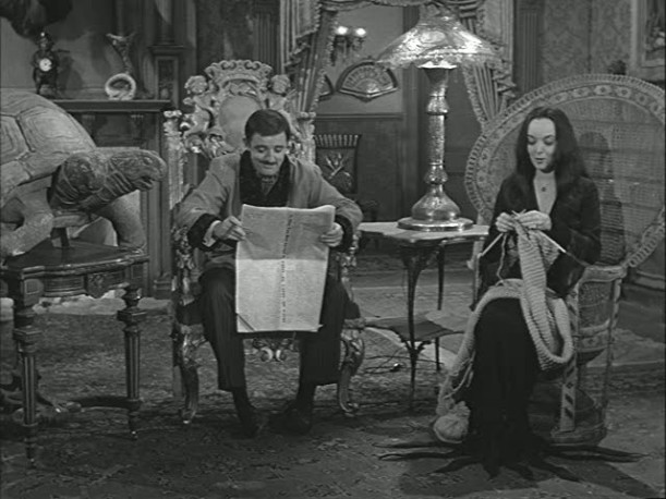 Gomez and Morticia in chairs