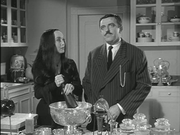 Morticia-Gomez in kitchen
