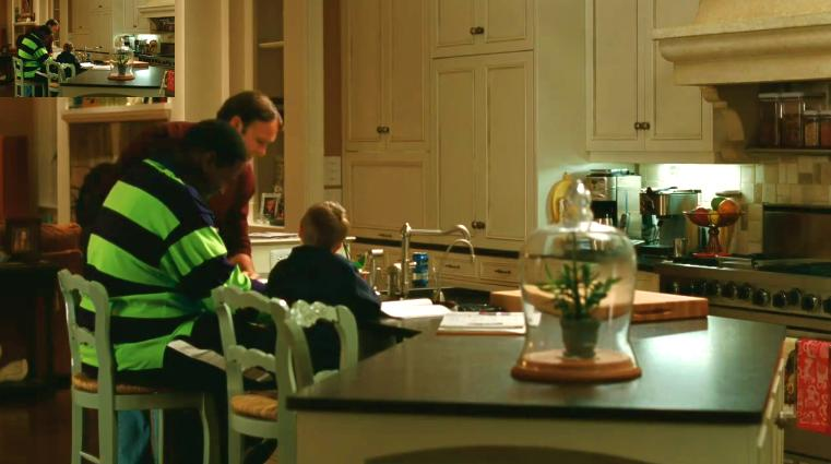 family sitting at kitchen island