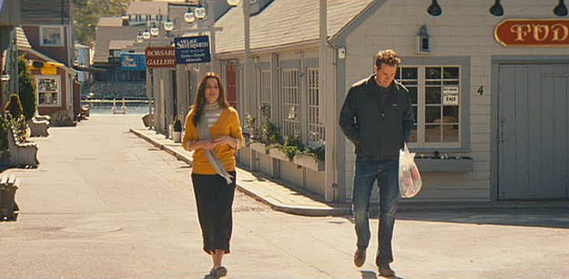 Sandra Bullock and Ryan Reynolds walking together through Rockport