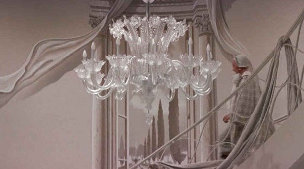 the third chandelier she hung in foyer