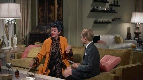 Auntie Mame talking to nephew on sofa