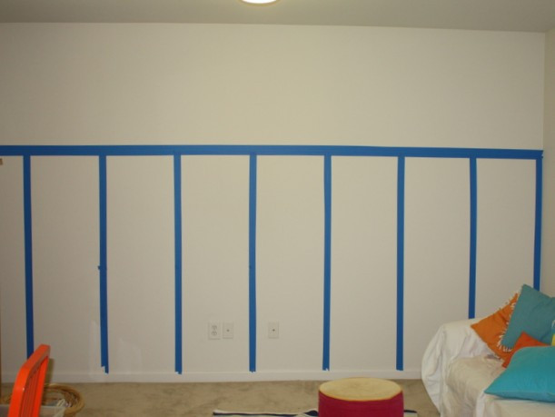 planning where board and batten will go with blue painter\'s tape