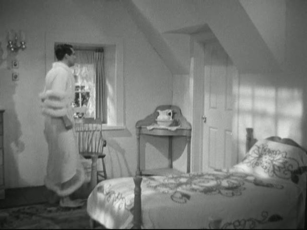 Cary Grant in dressing gown in bedroom