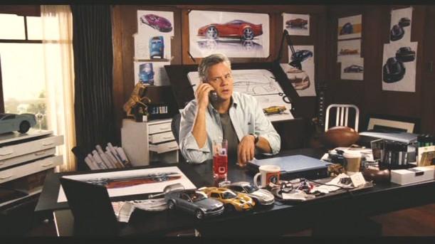Tim Robbins sitting at a desk in Zathura movie