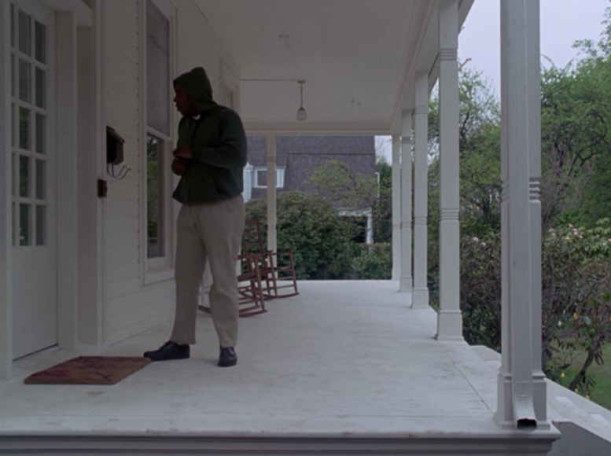 A man standing on front porch