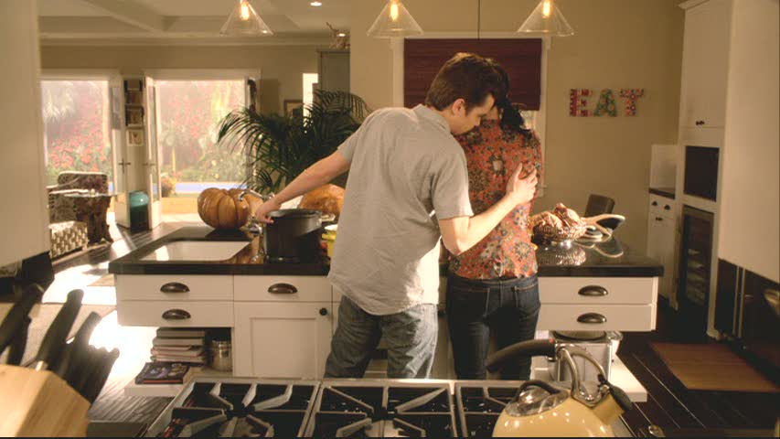 EAT sign - Travis and Jules in kitchen