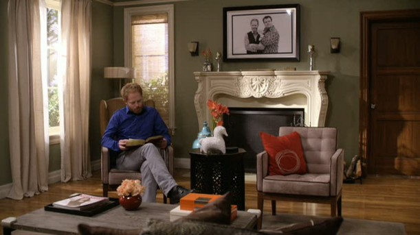 Mitchell reading by his fireplace in Modern Family