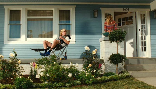 Owen Wilson on porch of You Me and Dupree Craftsman