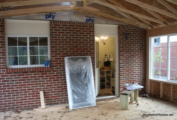 inside sunroom-brick wall