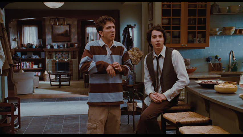 Paul Rust and Jack Carpenter standing in kitchen