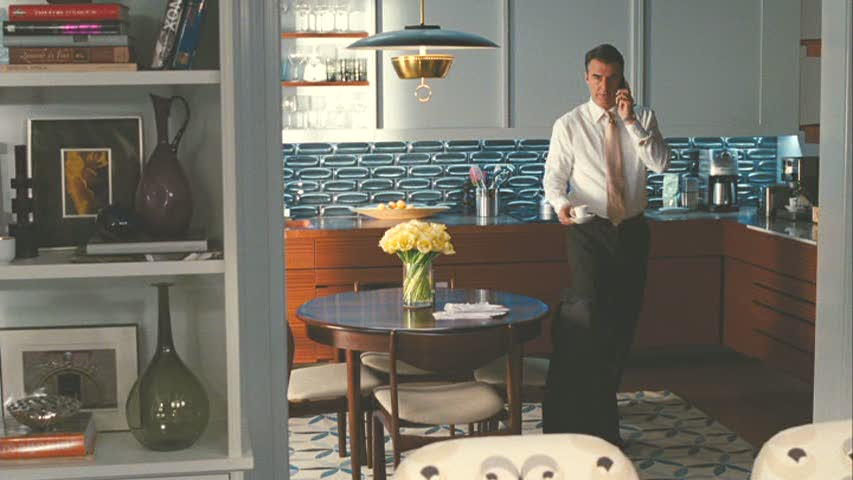Mr Big talking on phone in kitchen