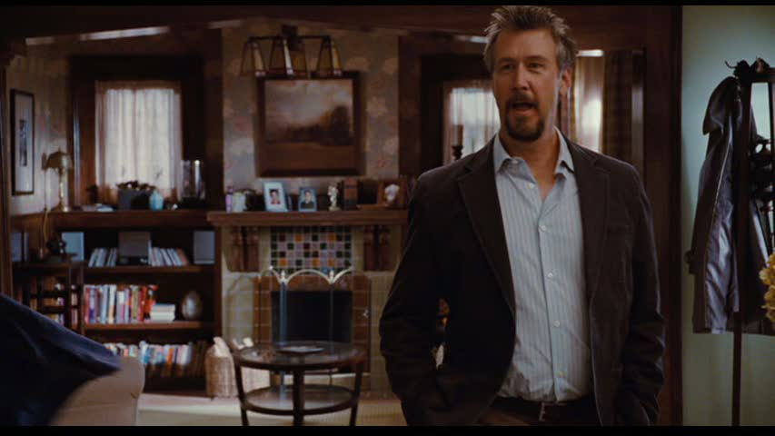 Alan Ruck standing in front of living room fireplace