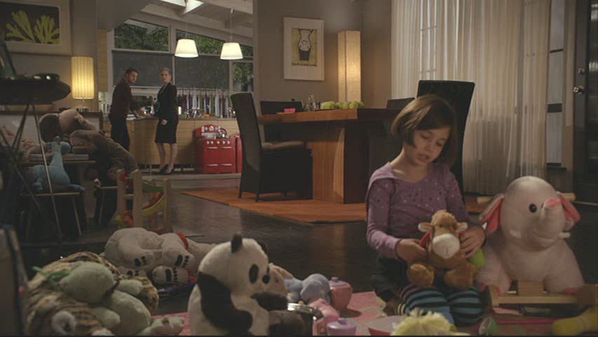 daughter playing with stuffed animals in dining room
