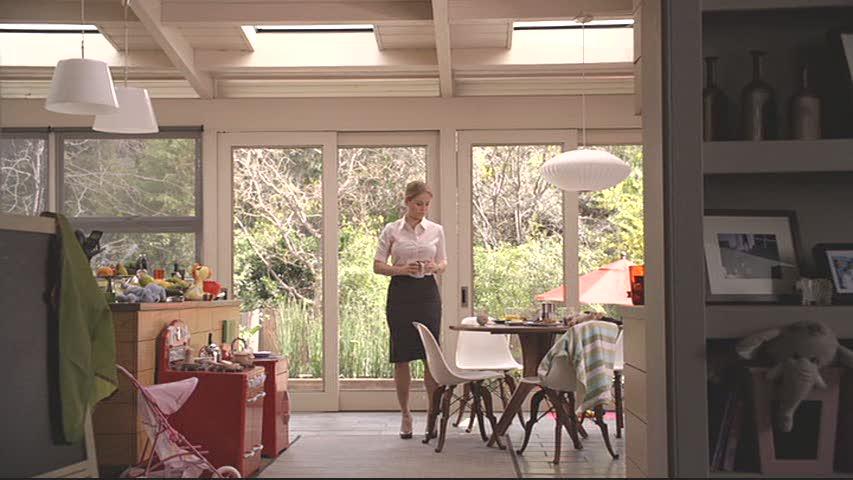 Julia standing in kitchen on Parenthood
