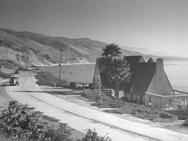 A beach house on the side of a road in Mildred Pierce