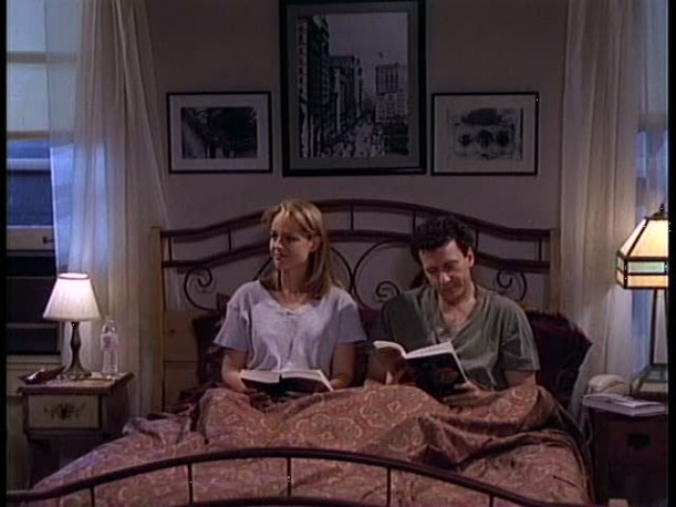 Paul and Jamie sitting in bed reading