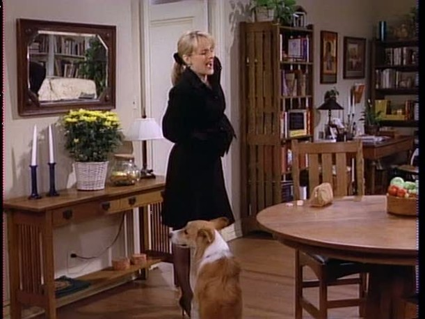 Jamie and her dog in the dining area of the apartment