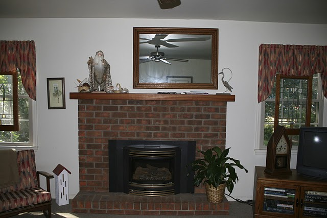A fireplace in a living room before redecorating