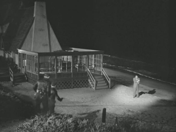 exterior of house at night by the beach