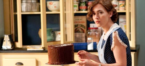 Kate Winslet as Mildred Pierce decorating cake in the kitchen