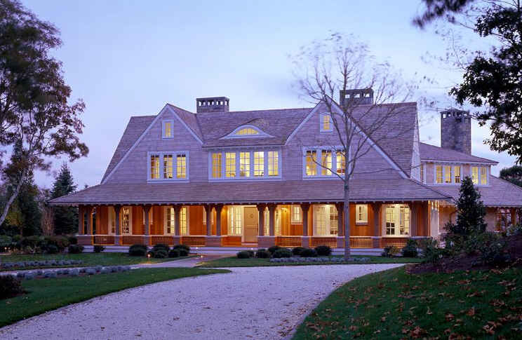 front exterior of Champlain\'s Bluff house with front porch and shingle siding
