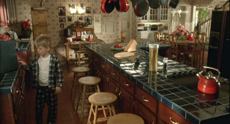 Kevin in the green and red Home Alone kitchen