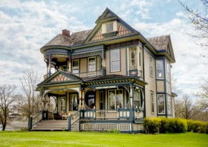 Queen Anne Victorian for sale in Osceola porch side view