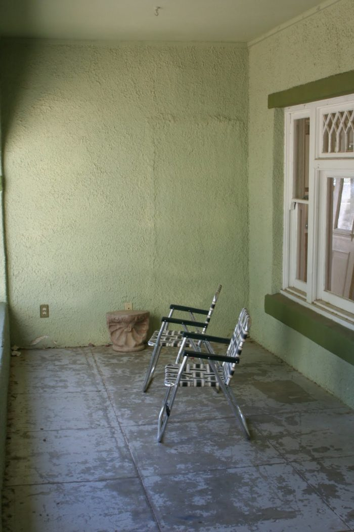 front porch with lawn chairs before remodel