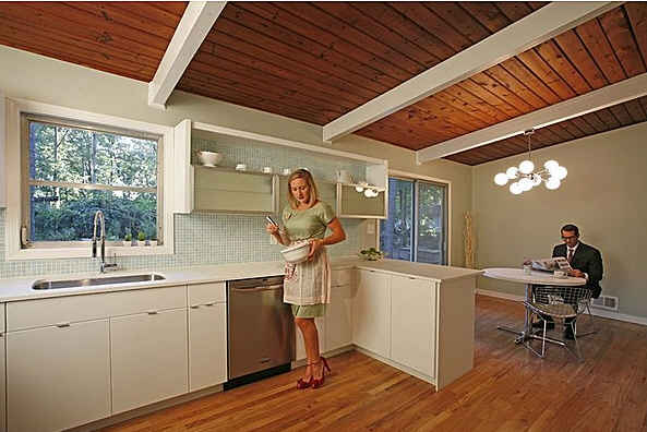 woman cooking in midcentury modern kitchen