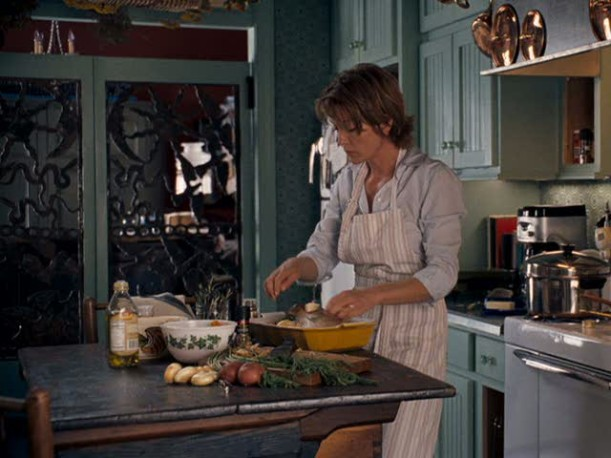 Diane Lane cooking in the kitchen