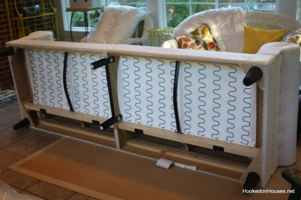 putting together the sofa in the sunroom