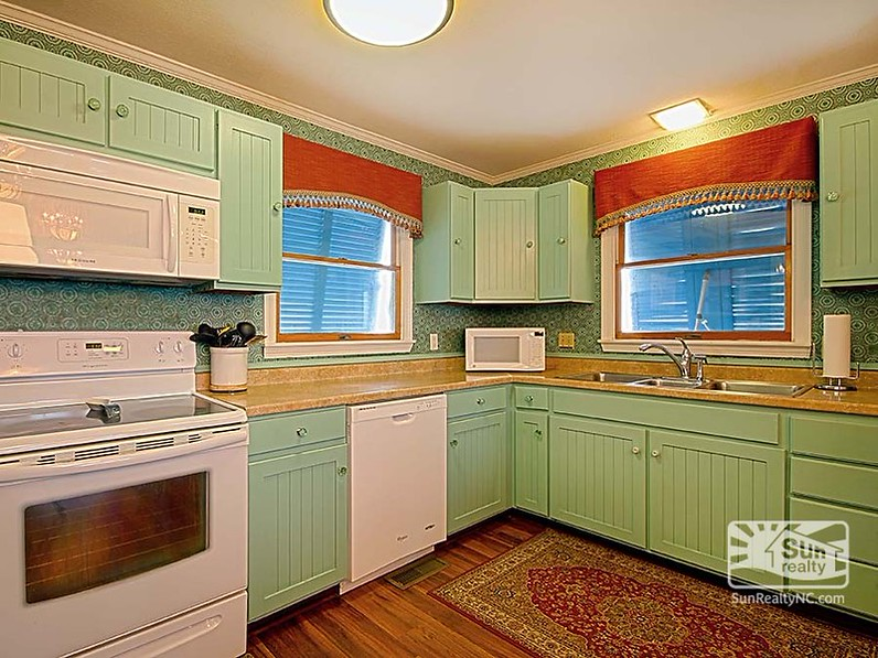 The inn\'s kitchen with painted cabinets