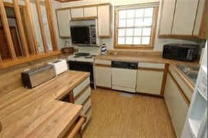 A kitchen with wooden cabinets before remodel