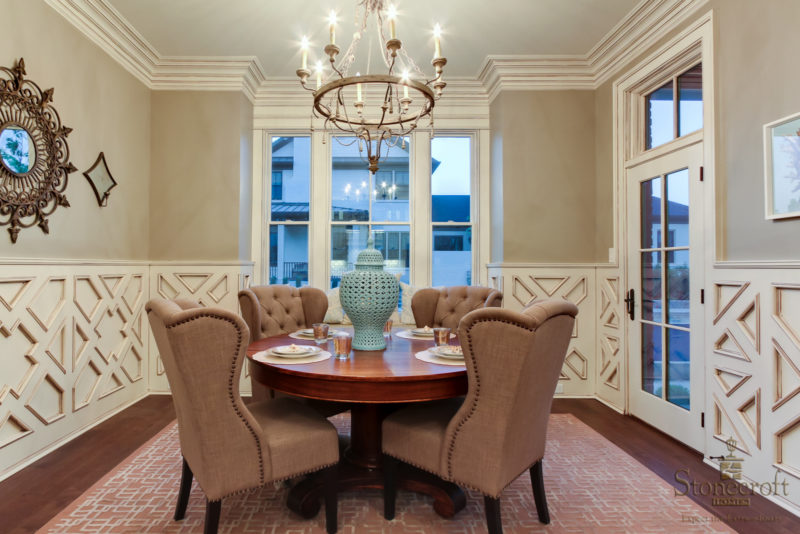 round dining table and armchairs