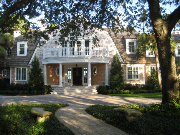 front exterior of shingle style house with black door