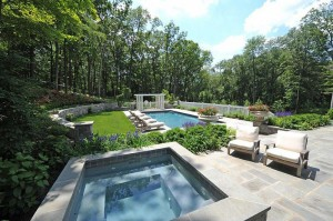 landscaped backyard with pool
