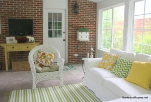striped rug, sofa, brick wall 7-11
