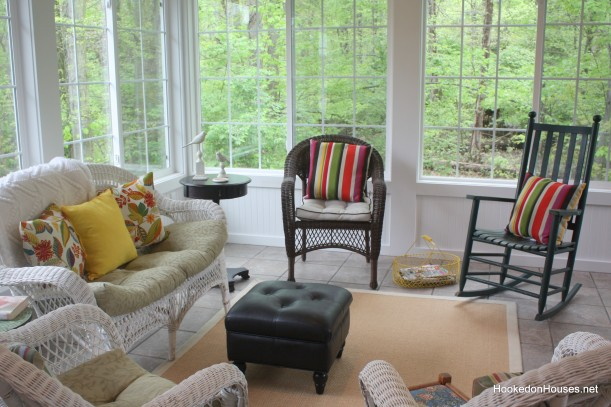 wicker chair and sofa in sunroom before it was decorated