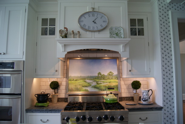 A kitchen with a clock over range