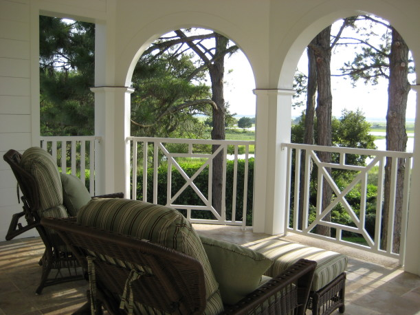 chair on covered balcony with view of the marsh
