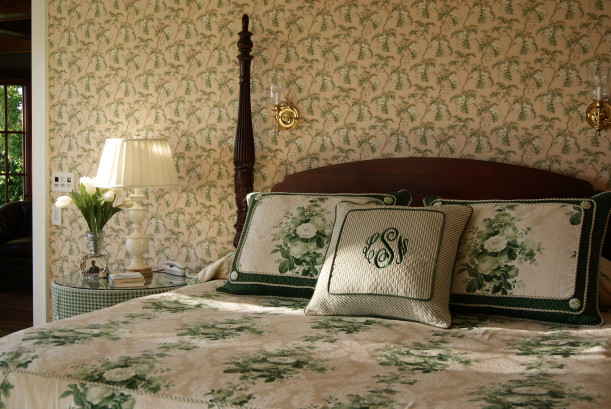 closeup of headboard and monogrammed pillow